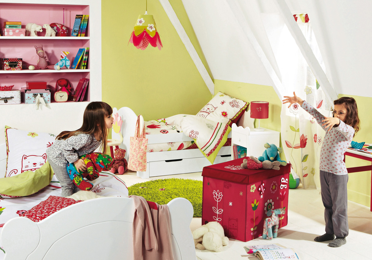Colorful kids room interior with sloping ceiling