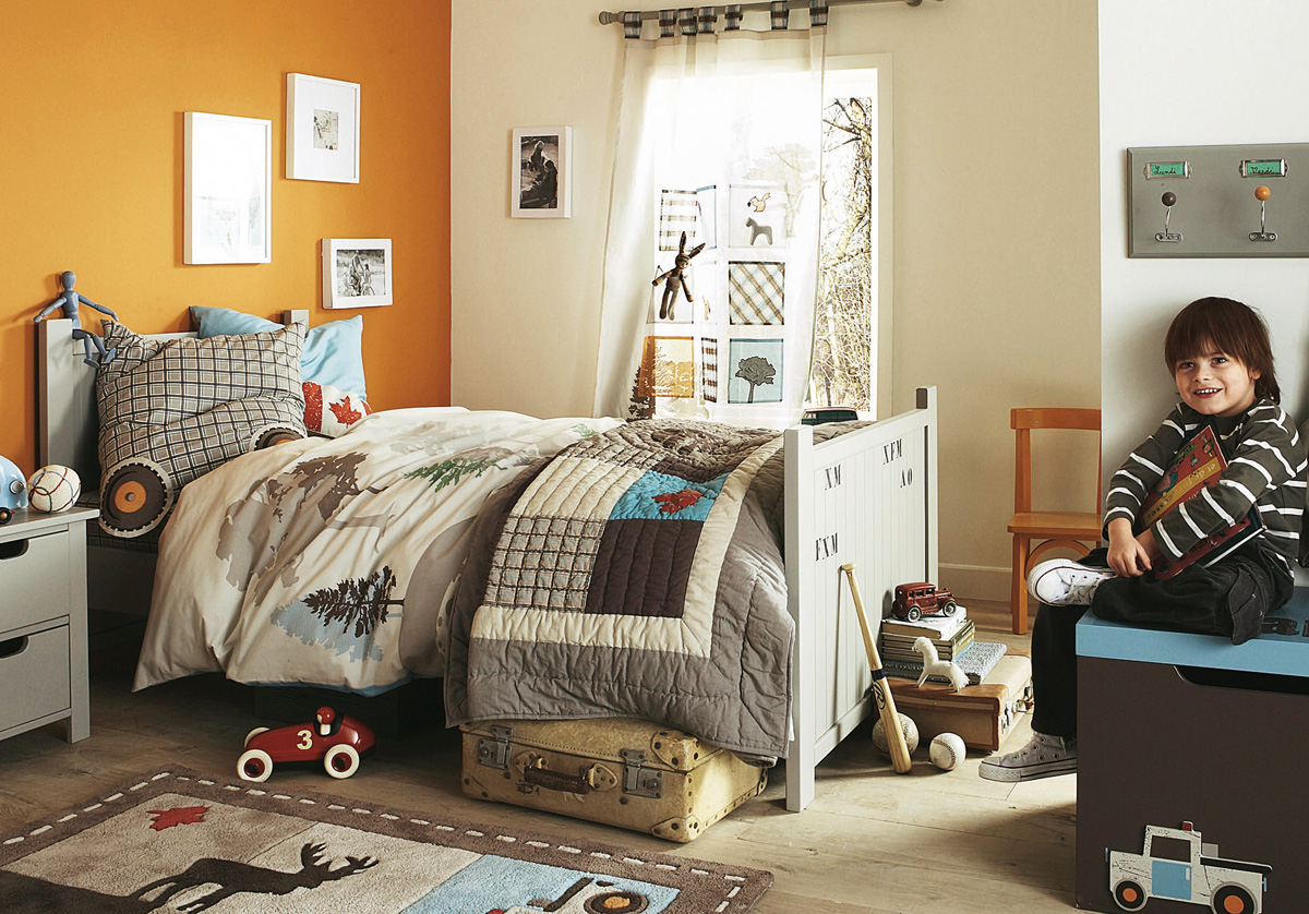 Orange And White Wall With Colorful Bedding