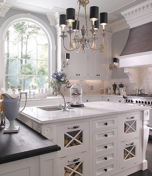 White kitchen with black lamps
