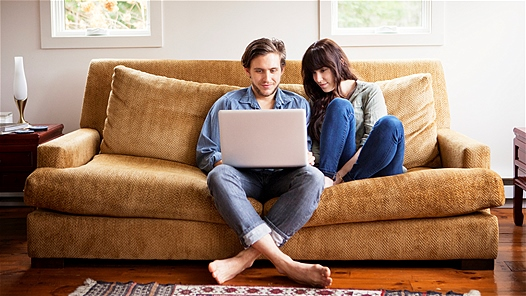 Relaxed couple on sofa