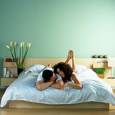 Happy couple in clean bedroom