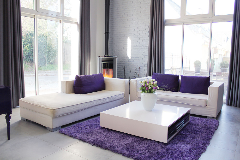 Contemporary White Home With Cute Colorful Interior Design  White Sofa Combined With Purple Cushions And Furry Rug