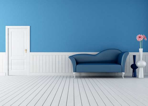 BLUE SOFA BLUE WALLS AND WHITE DOOR