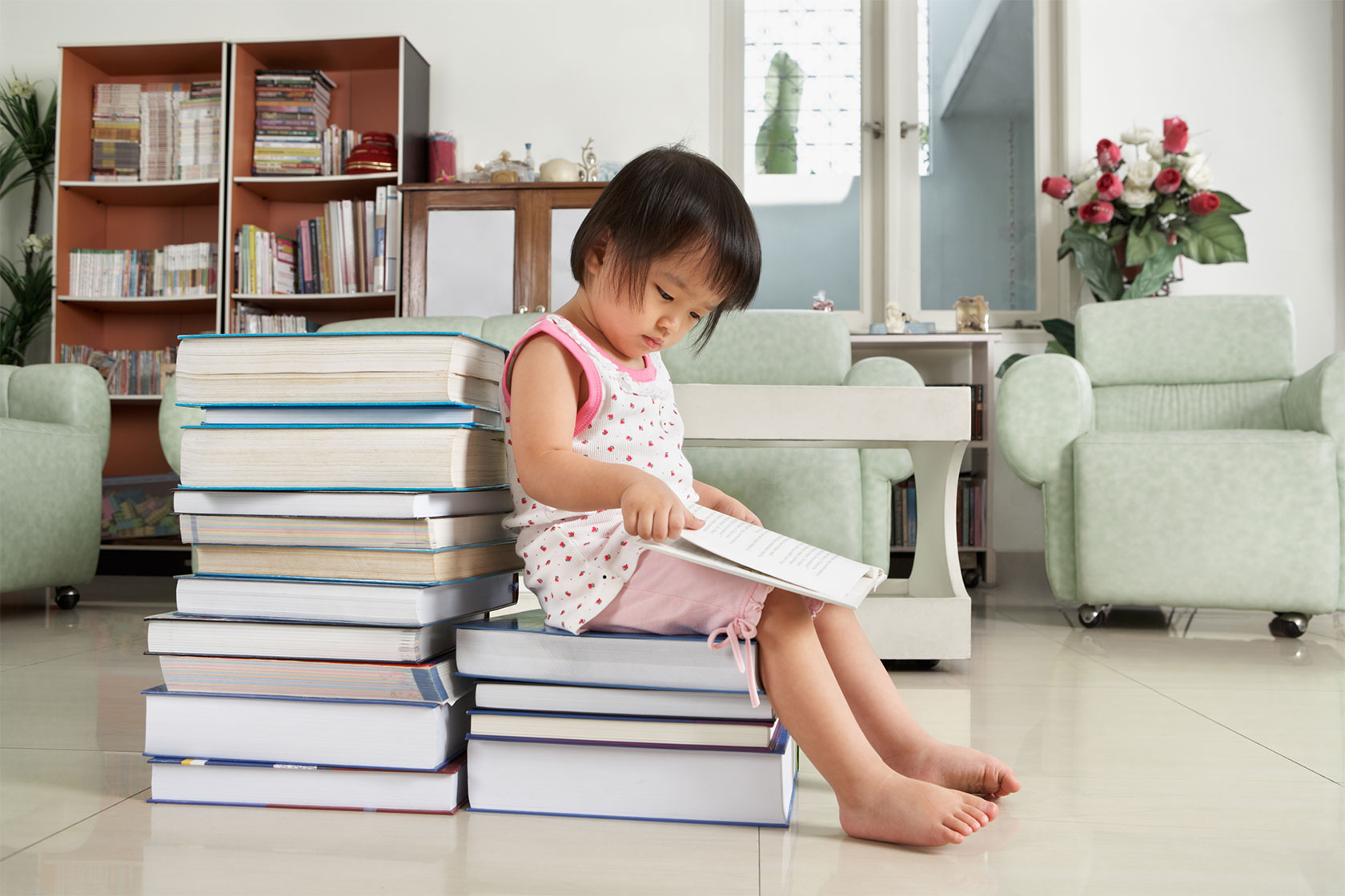 Little Girl Reading Lot of Books
