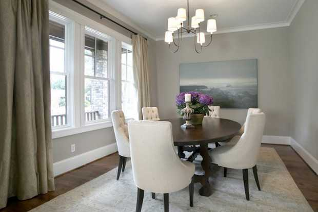 Dining-Rooms-Ivory-Tufted-Dining-Chairs-Round-Dining-Table-Rug-Art