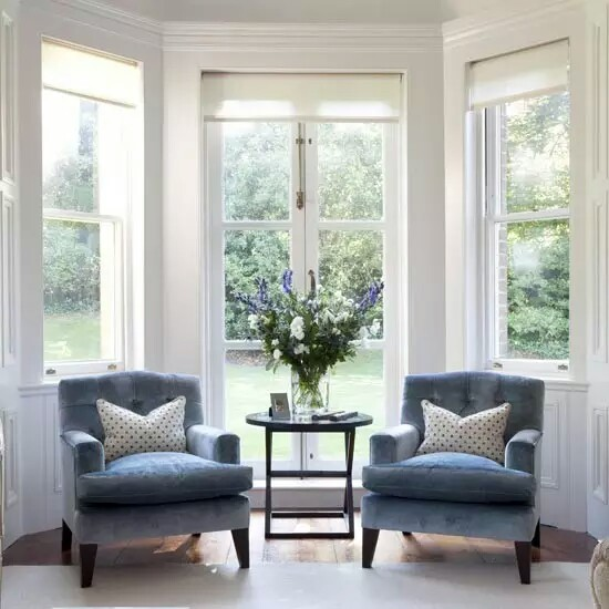 French Windows With Blue Velvet Chairs