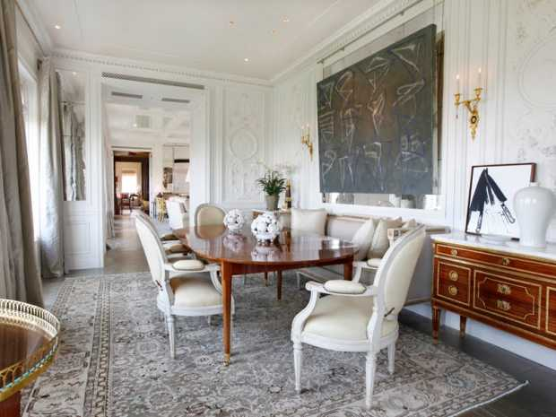 formal dining room paneling walls decorative molding louis chairs oval table traditional