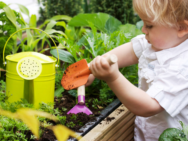 Child Uses Gardening Tools
