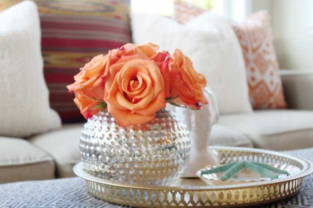 Ottoman Decor Silver Tray Mercury Vase Orange Roses Flowers in Living Room