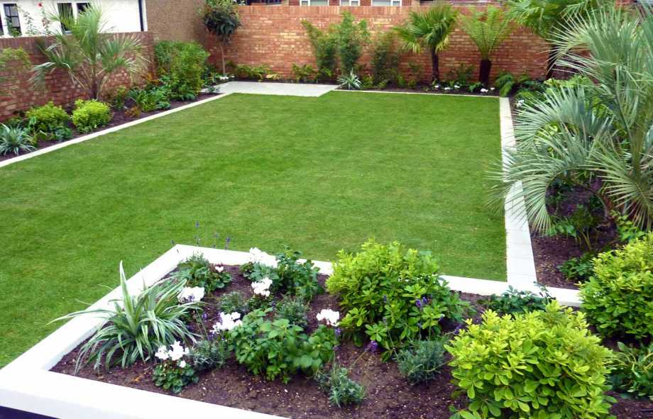 Simple-Backyard-Outdoor-Garden-with-Large-Green-Grass-and-Some-Palm-Trees-Decorating-also-Brick-Fence-for-Modern-Garden-Design-Ideas
