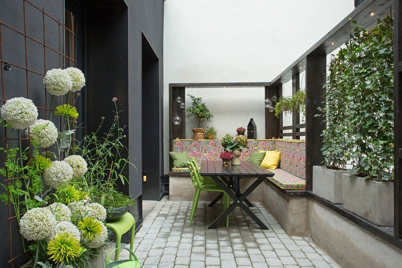 fancy-small-and-covered-indoor-garden-with-dining-area-in-chic-apartment-in-strahattfabriken-applied-darkwood-dining-table-and-green-chairs