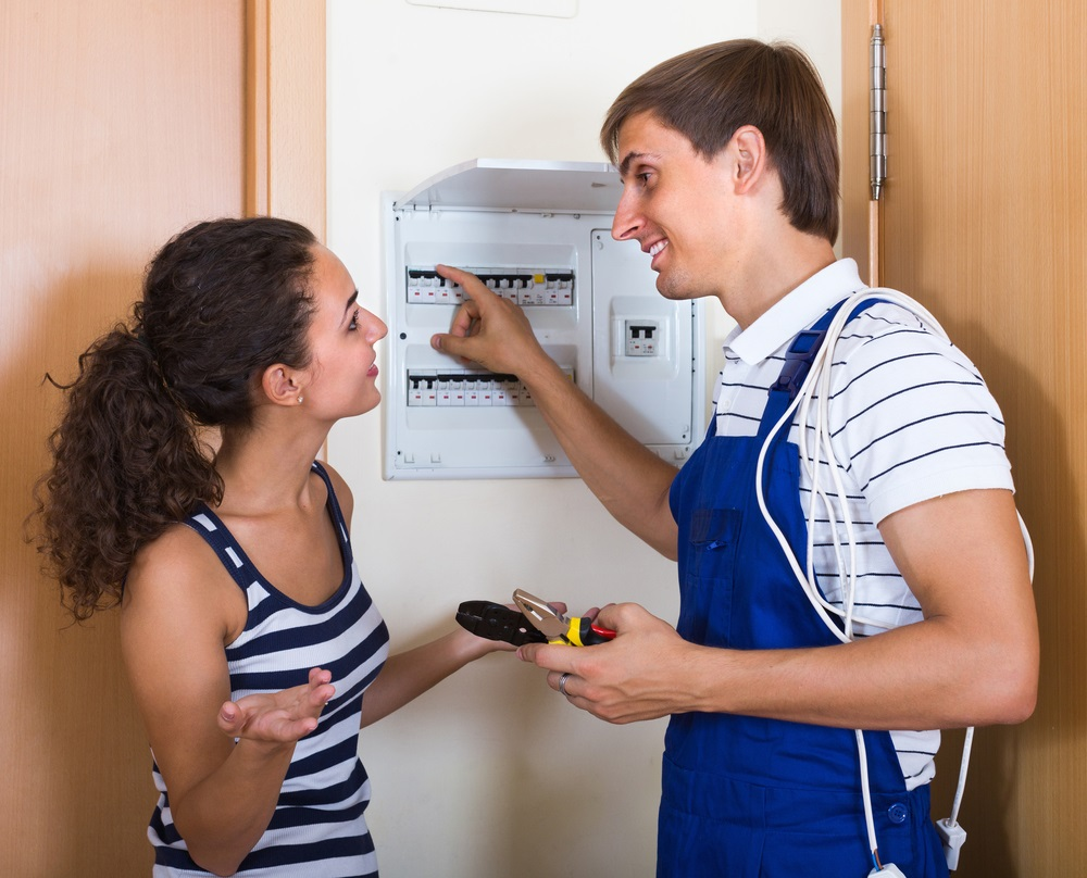 Electrician Talking With A Woman