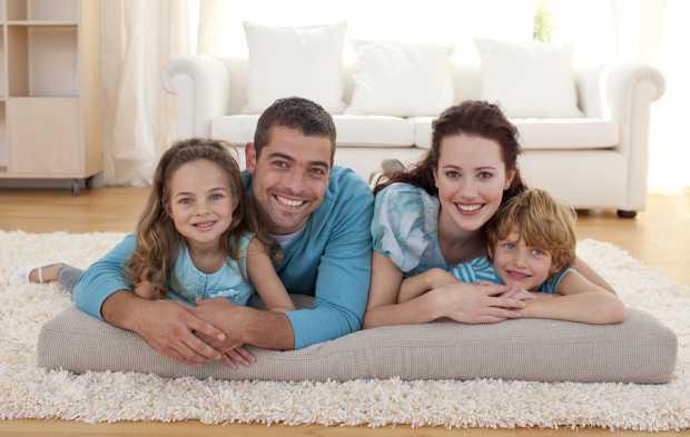 Family On Floor In Temporary Living Room