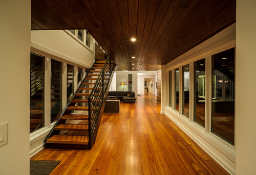 Open Staircase With Wooden Treads And Dark Steel Handrail