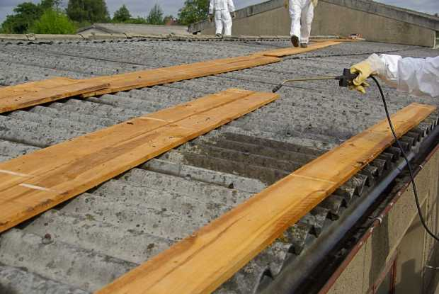 Experts work on Asbestos Removal