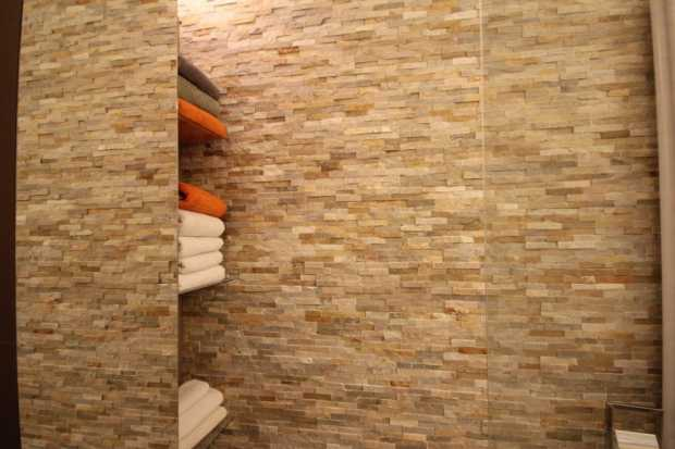 Ivory Natural Stone Cladding In Bathroom