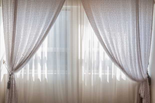 Use Soundproof Curtains