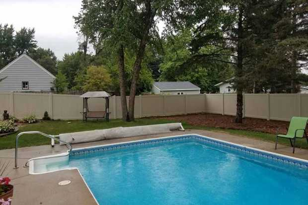 Tall Fence Around The Backyard