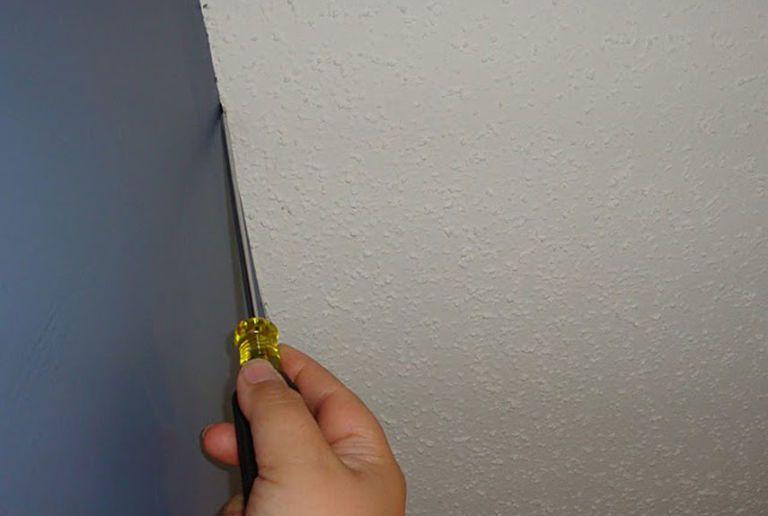 Use A Screwdriver To Scrape The Ridges