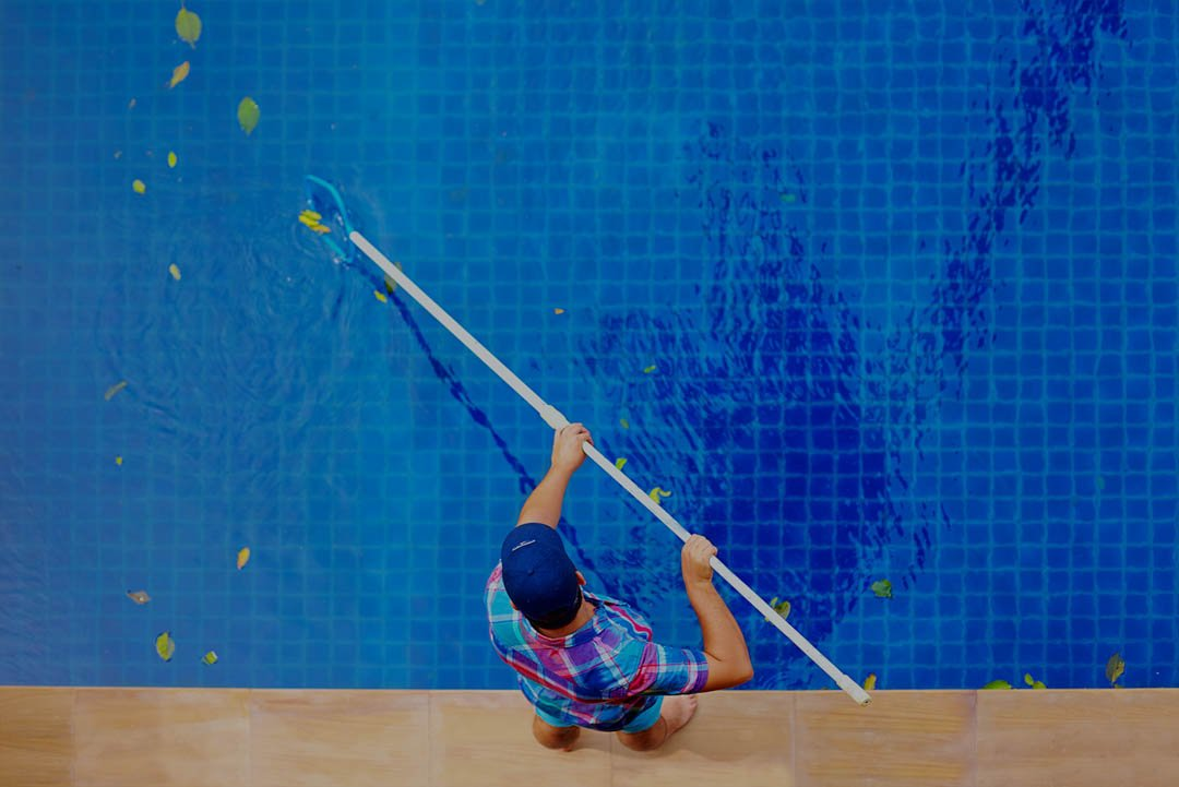 Skimming And Scrubbing A Pool