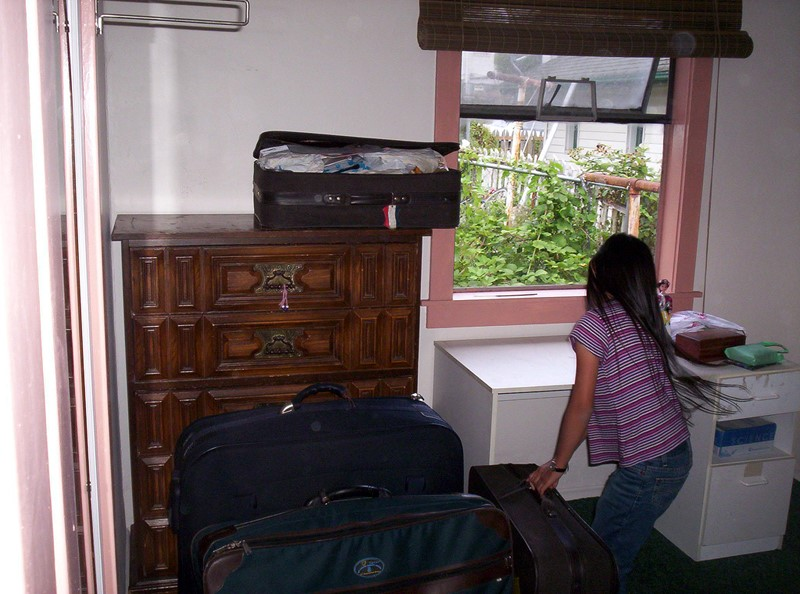 Teenager Unpacking After Move