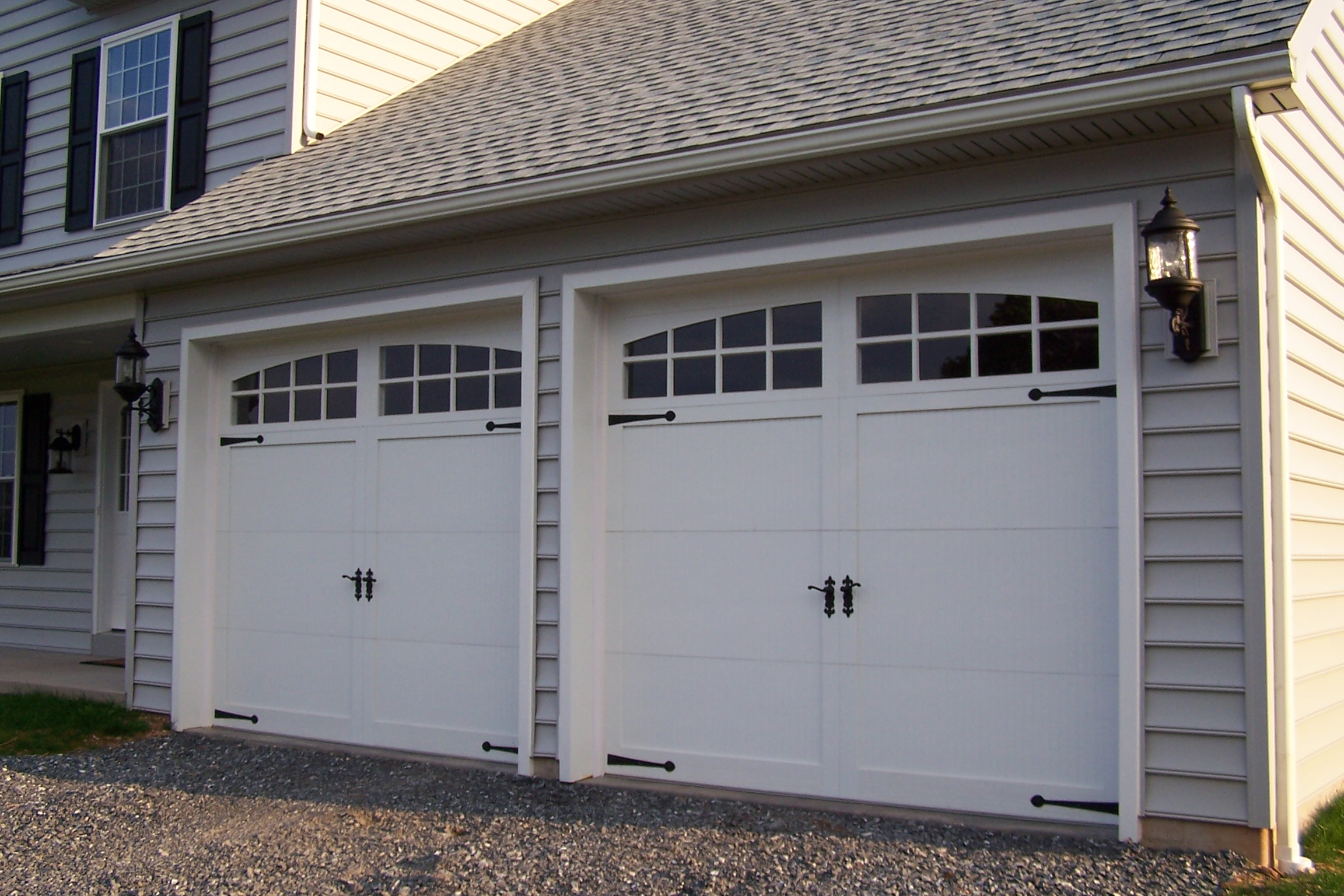 My Garage Door Is Really Old. Should I Replace It Or Repair It?