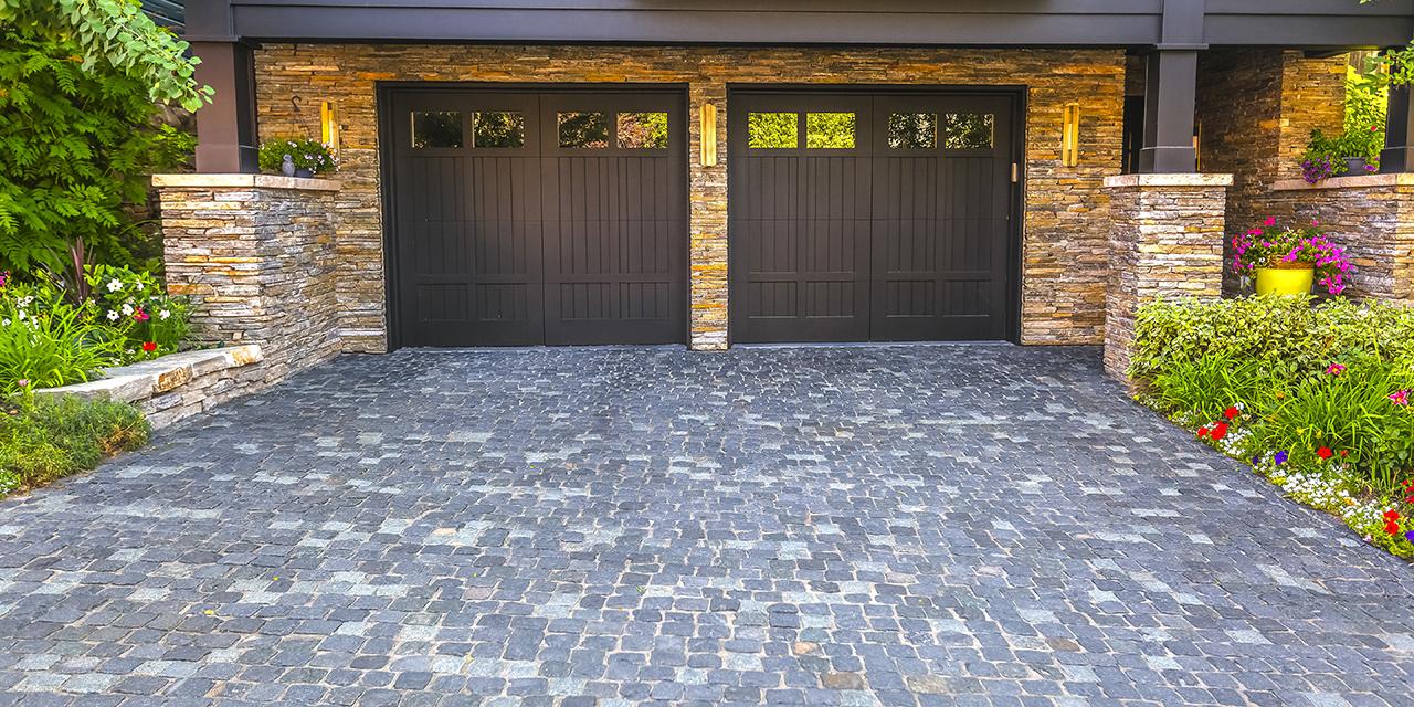 Brick Stone Driveway Double Garage Doors